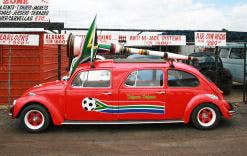 The red Beetle carries a large vuvuzela on its roof.