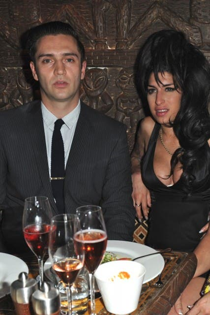 Amy Winehouse, Reg Travis eating dinner at Shaka Zulu in Camden