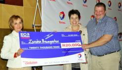 Vivacious Zenobia Baumgarten and her husband Herman (right) accept the prize for winning the Total Eco Pioneer Challenge.  (Image: Total South Africa)