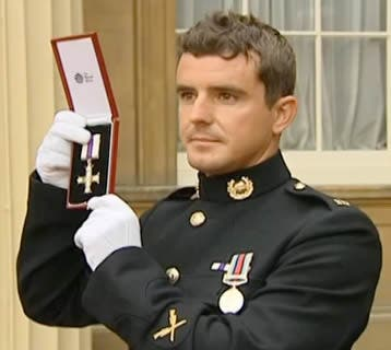 Marine Craig Buchanan receives the Military Cross at Buckinham Palace