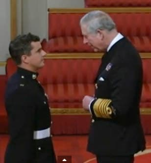 Southern African Craig Buchanan receives his medal from Prince Charles