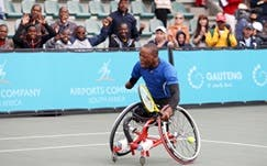 Supporters cheer on South African wheelchair tennis quad star Lucas Sithole at the 2013 Acsa SA Open (Photo: Reg Caldecott)