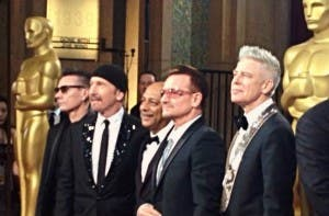 Anant Singh (centre) with U2 at the Oscars earlier this month. U2 were nominated for the film's song 'Ordinary Love'