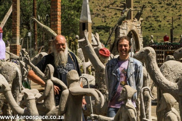 Rod and Shugg amongst the biblical characters outside the Owl House in Nieu-Bethesda.