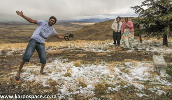 Gauteng overlanders jump out of their heated cars and play like children.