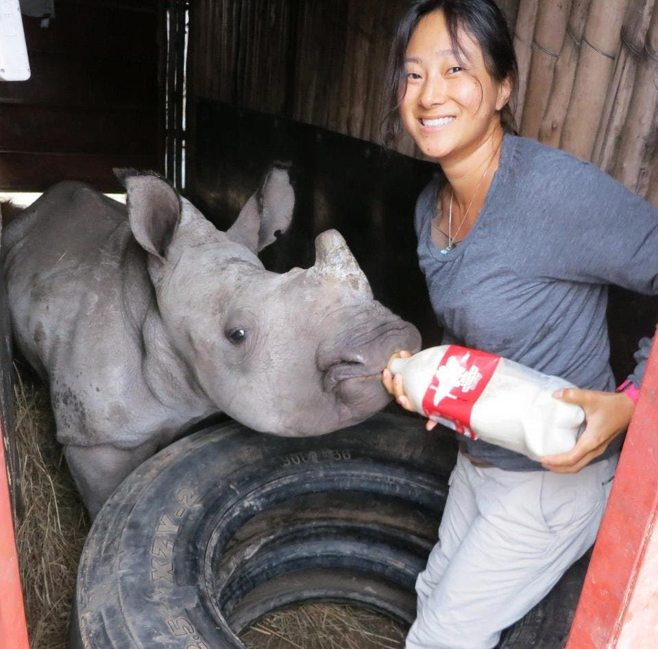 Kim Putman with baby rhino in South Africa
