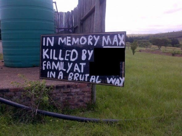 Sign erected at the site where Max was allegedly beaten to death