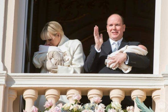 South African Princess Charlene kisses her baby on Palace balcony