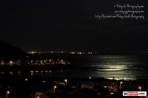 "Photo: Robyn Gwilt - ""Full Moon over Kalk Bay, taken from Fish Hoek - #TakeThatEskom!"""