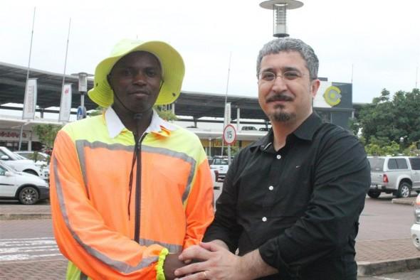 Methode Kubwayo and Ismail Teke celebrate the good deed.