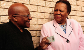Archbishop Desmond Tutu receives a Smart ID Card, 25 July 2013 Home Affairs Minister Naledi Pandor hands over a Smart ID Card to Archbishop Desmond Tutu at Frazzitta Business Park in Milnerton. (Photo: GCIS)