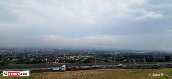 "Cape Town today. Photo: Jana Brits‎ - ""The blazing mountains covered in smoke, clouds and rain."""