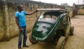 Segun Oyeyiola shows off his solar- and wind-powered Beetle (Image: OAU Peeps)