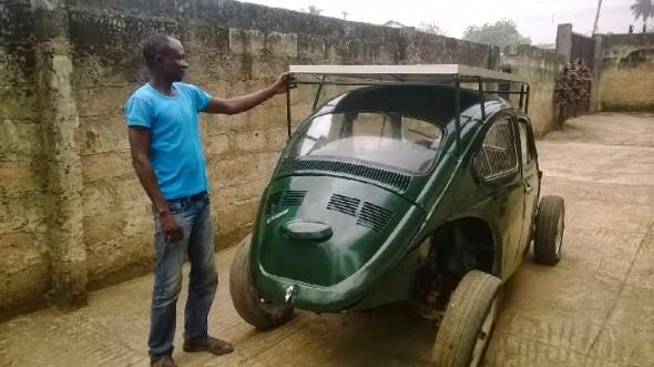 Segun Oyeyiola shows off his solar- and wind-powered Beetle (Image: OAU Peeps)