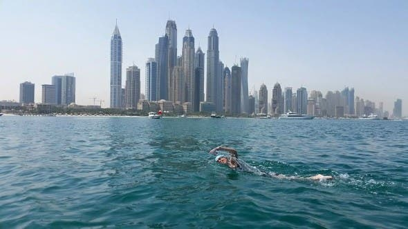 Kieran nearing finish strait - Dubai Marina in background with tallest residential towers in the world.