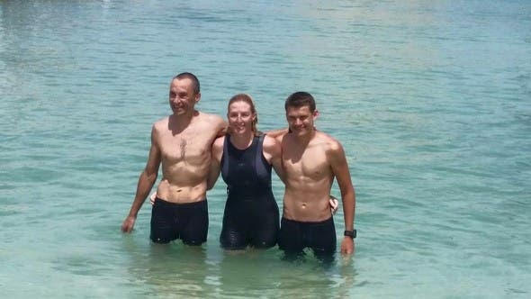 Photo: Linda Mensova. All three swimmers at the finish line.