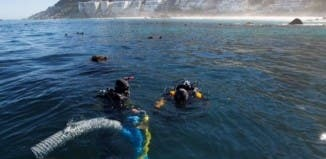 Underwater archaeology researchers explore the site of the São José slave ship wreck near the Cape of Good Hope in South Africa. Susanna Pershern/Courtesy of U.S. National Parks Service