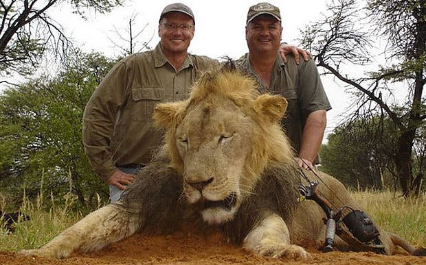 Palmer, on the left, with one of his trophy kills