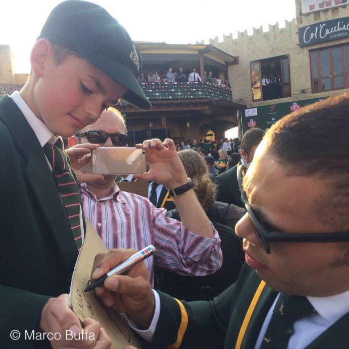 Bryan Habana signs an autograph in South Africa