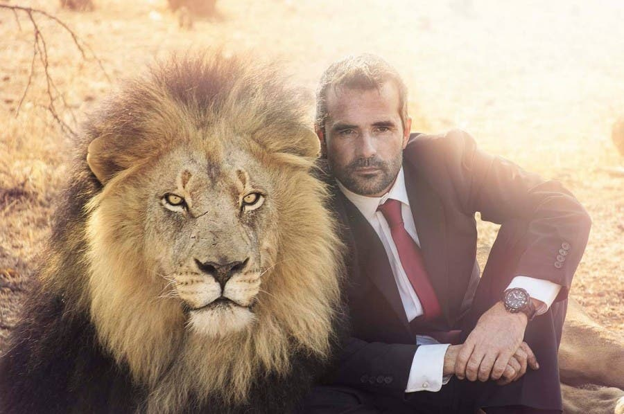 Kevin Richardson in an ad with a lion