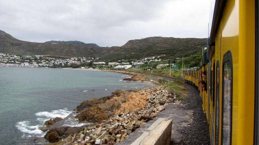 On the train to Simonstown, riding along False Bay. Photo- SA Railways.