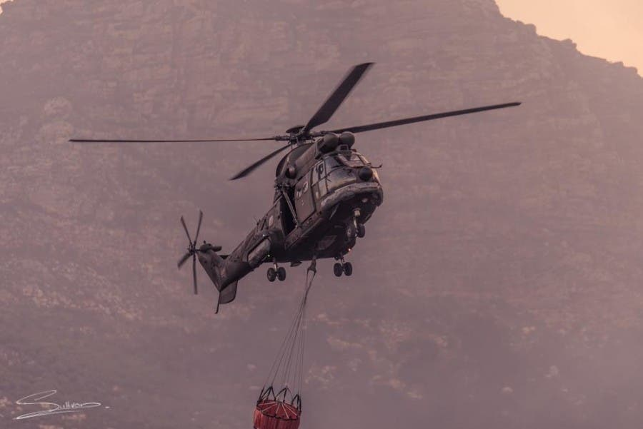 Fire helicopter with mountain