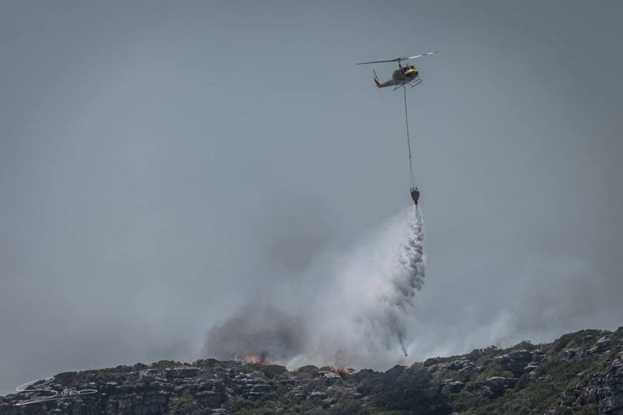 Helicopter putting out fires