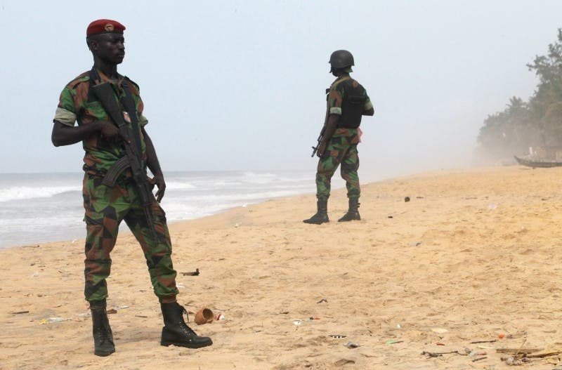 Soldiers stand guard on the beach following an attack by gunmen from al Qaeda's North African, in Grand Bassam, Ivory Coast, March 14, 2016. REUTERS/Luc Gnago