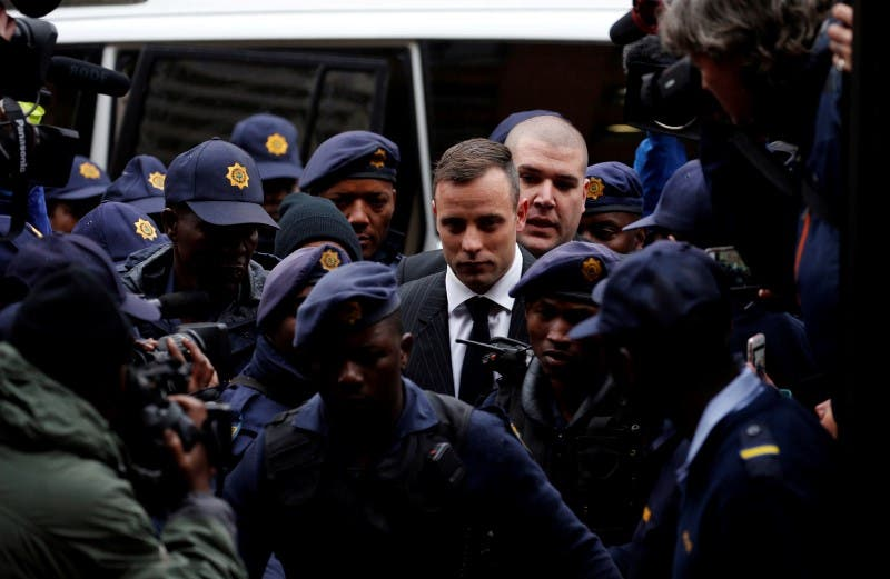 Former Paralympian Oscar Pistorius arrives to be sentenced for murder of his girlfriend Reeva Steenkamp, at the Pretoria High Court, South Africa June 13,2016. REUTERS/Siphiwe Sibeko
