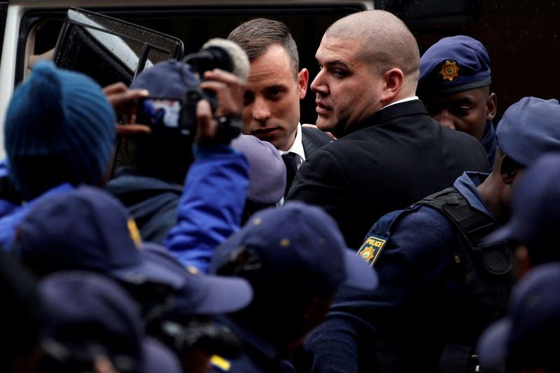 Former Paralympian Oscar Pistorius arrives to be sentenced for the murder of his girlfriend Reeva Steenkamp at the Pretoria High Court, South Africa June 13,2016. REUTERS/Siphiwe Sibeko