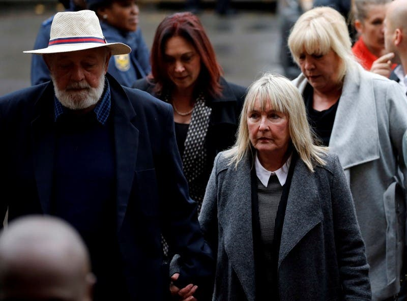 Barry Steenkamp (L), father of Reeva Steenkamp, arrives with his wife June Steenkamp for the sentencing of former Paralympian Oscar Pistorius at the Pretoria High Court, South Africa June 13,2016. REUTERS/Siphiwe Sibeko