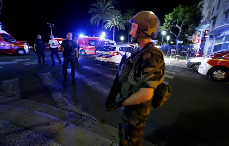 French soldiers cordon the area after at least 30 people were killed in Nice, France, when a truck ran into a crowd celebrating the Bastille Day national holiday July 14, 2016.  REUTERS/Eric Gaillard