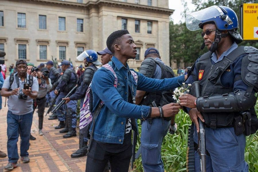 Photo shot by Ihsaan Haffejee for GroundUp at Wits on 04 Oct. , of Panasha Sibanda, a second-year economics and finance student. Hope blossoms…