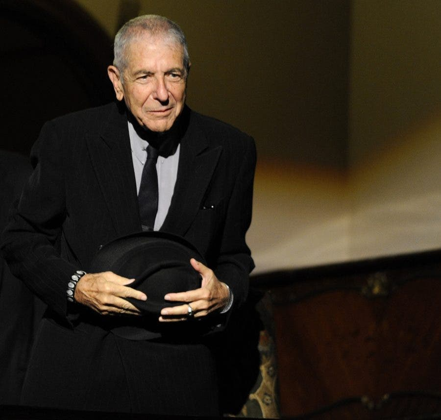 Canadian singer-songwriter Leonard Cohen attends a tribute in Gijon, northern Spain on October 19, 2011. REUTERS/Eloy Alonso/File Photo