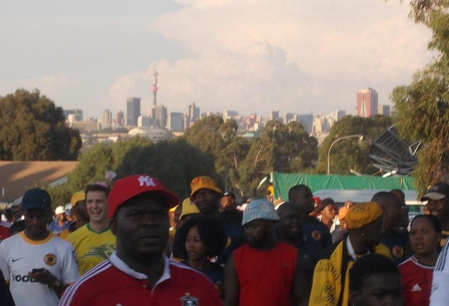 Fans Leaving Soccer City with skyline behind - Heritage Portal - 2016