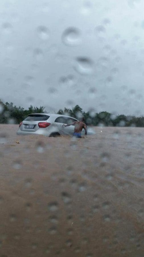 man saving woman in durban flood