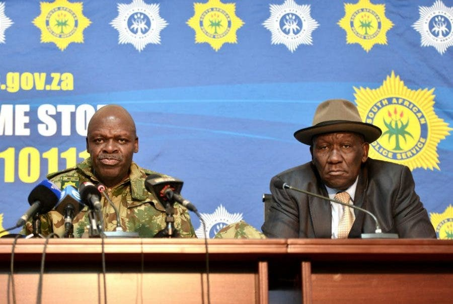 South Africa's police commissioner, Khehla Sitole, and police minister, Bheki Cele