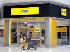 A shopper walks past an MTN shop at mall in Johannesburg