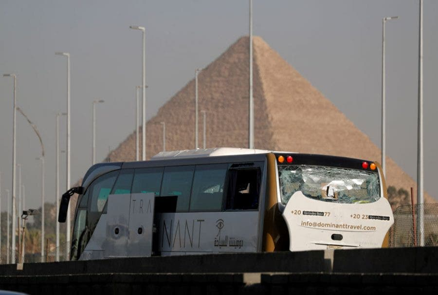 A damaged bus is seen at the site of a blast near a new museum being built close to the Giza pyramids in Cairo