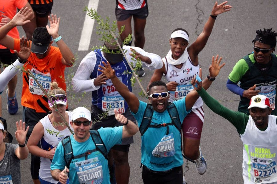 Activist and treegrower Sokomani celebrates as he approaches the final stretch of the Cape Town marathon