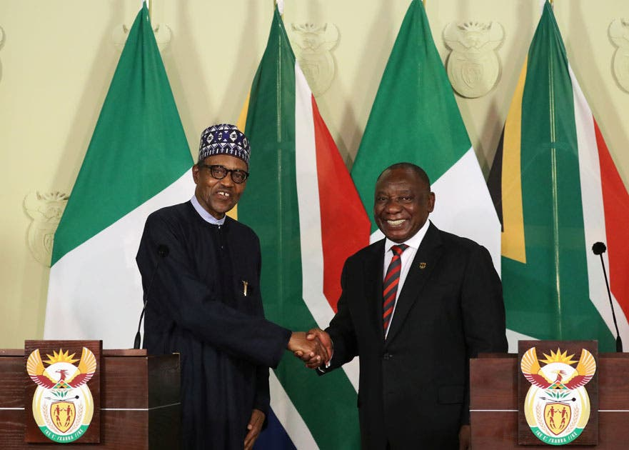 Nigeria's President Muhammadu Buhari shakes hands with his South African counterpart Cyril Ramaphosa