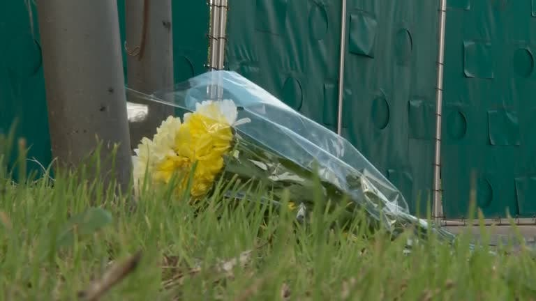 Essex resident lays flowers at scene where bodies found in lorry