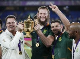 South Africa head coach Rassie Erasmus and South Africa's RG Snyman pose with the Webb Ellis Cup they celebrate winning the world cup final.