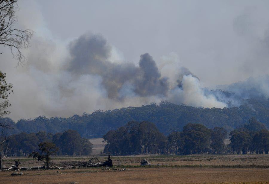 Smoke from a large bushfire is seen outside Wytaliba, near Glen Innes