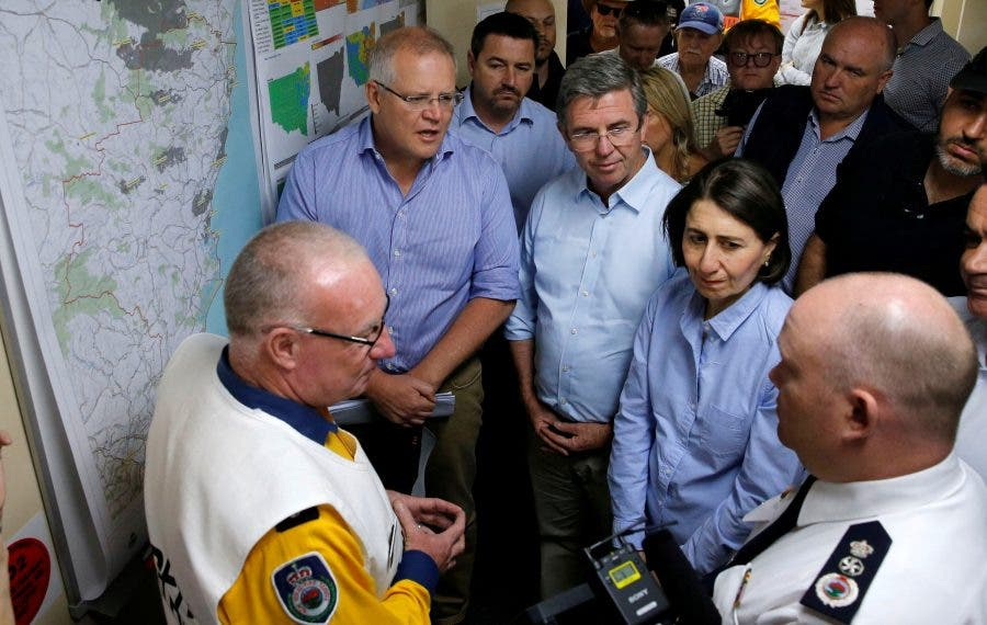 Australia's Prime Minister Scott Morrison and New South Wales Premier Gladys Berejiklian receive briefing on the fires at Mid North Coast Fire Control Centre in Wauchope
