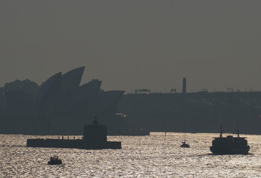 The Sydney Opera House is seen through smoke from bushfires in Sydney