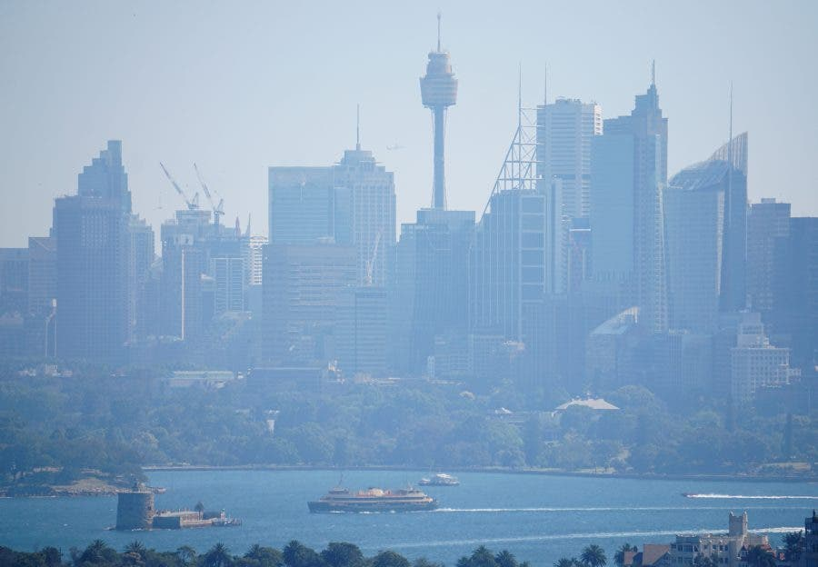 A ferry passes in front of the Central Business District as smoke from bushfires shroud Sydney