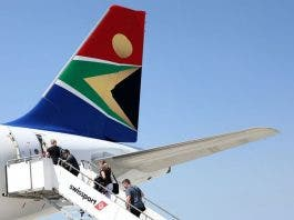 assengers board a South African Airways plane at the Port Elizabeth International Airport in the Eastern Cape province