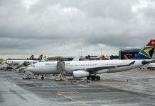 SAA aircraft stand on the runway at O.R. Tambo International Airport in Johannesburg