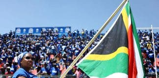 Supporters of South African opposition party, the Democratic Alliance attend the party's election manifesto launch in Johannesburg